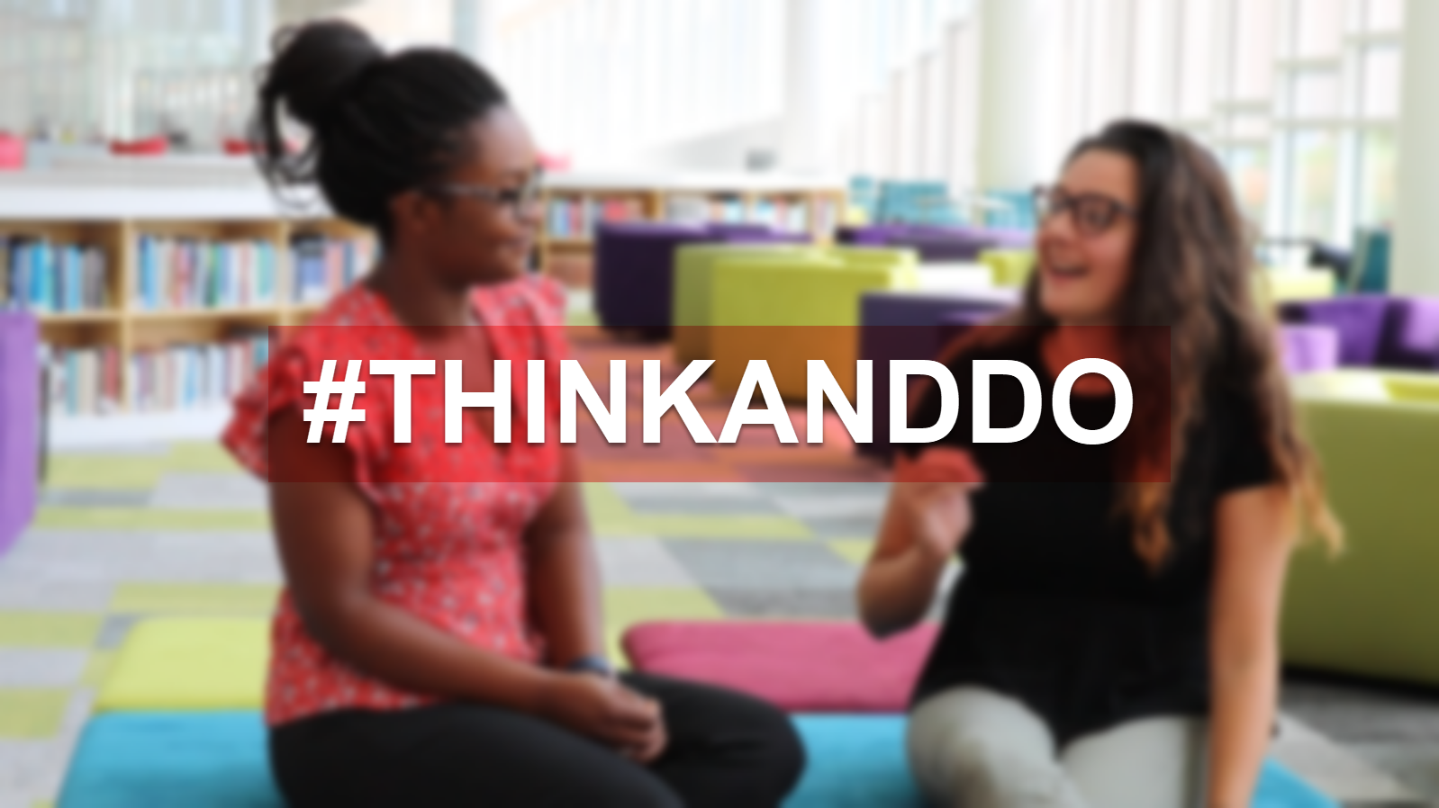 Two Students Talking with the hashtag think and do over it