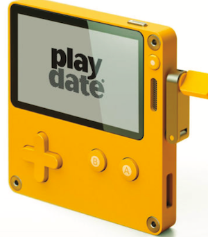 yellow handheld gaming device with hand crank