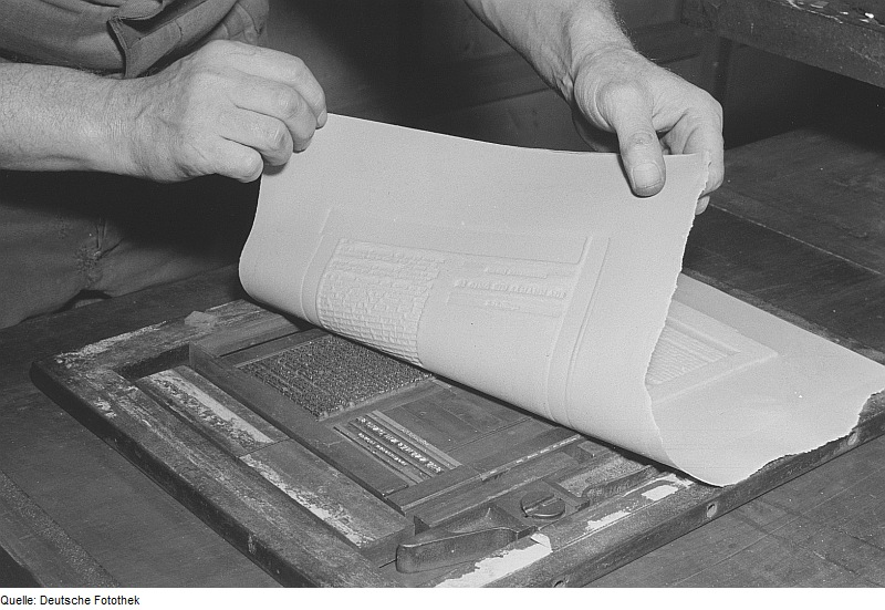 "Paper maché flong on a type form. ""Herstellen einer Mater (Stereotypie)."" Roger and Renata Rossing. Deutsche Fotothek, 1953."